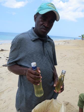 El vendedor de coco y aceite